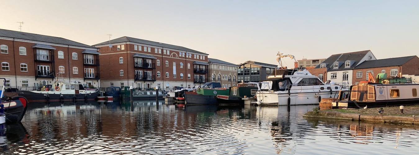 Diglis Basin with moored canal narrowboats and river vessels
