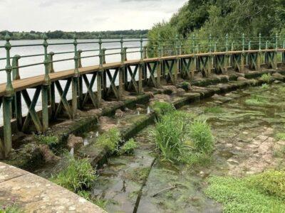 Cast iron walkway across the overflow weir of Ravensthorpe Reservoir